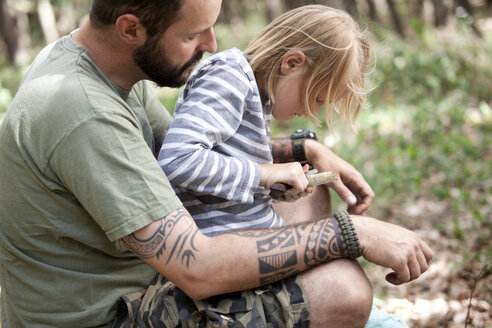 Father and daughter carving in the forest - MFRF01000