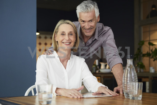 Portrait of smiling mature couple at home - RBF05915