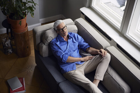 Pensive mature man on couch at home - RBF05948