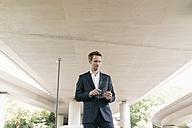 Businessman using portable glass device - KNSF02497