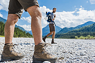 Germany, Bavaria, legs of hiker walking in dry creek bed - DIGF02789