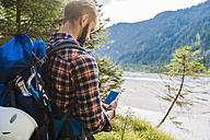Hiker orientating with cell phone - DIGF02819