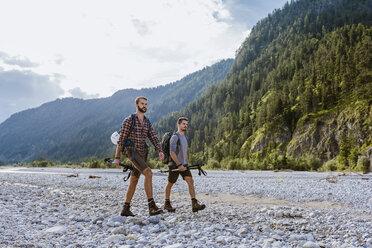 Germany, Bavaria, two hikers walking in dry creek bed - DIGF02822