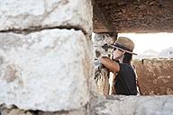 Spain, Menorca, woman inside building looking at view - IGGF00153