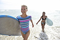 Two women in the sea with surfboards - ECPF00059