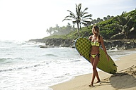 Woman on the beach with surfboard - ECPF00062