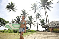 Woman at the coast with surfboard - ECPF00068
