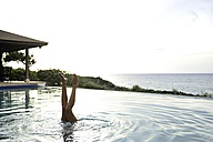 Legs of woman diving in swimming pool - ECPF00107