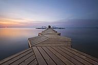 Spain, Murcia, Mar Menor, wooden pier at sunrise - DHCF00154