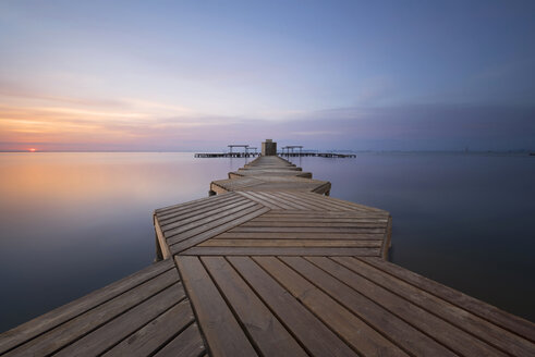Spain, Murcia, Mar Menor, wooden pier at sunrise - DHCF00154