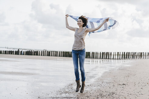 Happy woman with cloth on the beach - KNSF02563