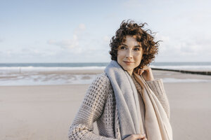 Portrait of smiling woman on the beach - KNSF02629