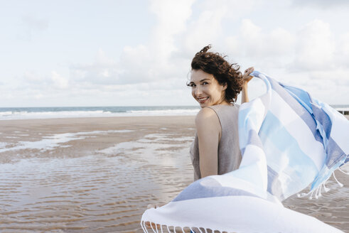 Happy woman with cloth on the beach - KNSF02641