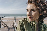 Portrait of woman on boardwalk at the beach - KNSF02686
