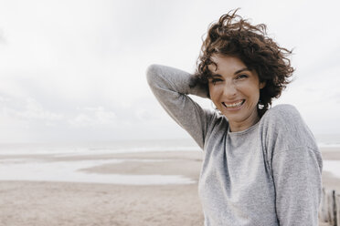 Portrait of happy woman on the beach - KNSF02701