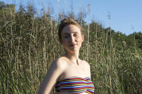 Young woman enjoying the sun at a lake - LMF00769
