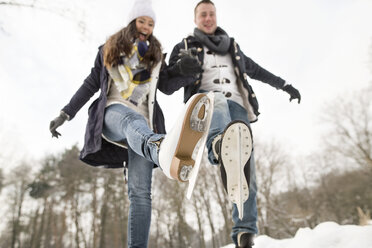 Couple ice skating on a frozen lake - HAPF02114