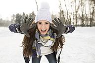 Woman having fun ice skating - HAPF02123