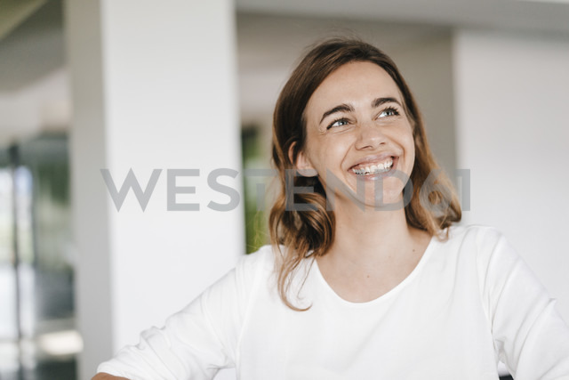 Portrait of a beaming young businesswoman - KNSF02714
