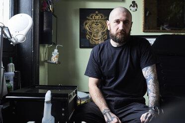 Portrait of tattoo artist in studio - IGGF00168