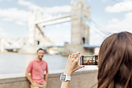 UK, London, tourists taking a picture near the Tower Bridge - MGOF03616