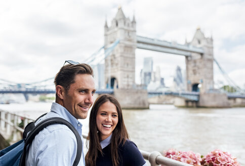UK, London, smiling couple with the Tower Bridge in the background - MGOF03622