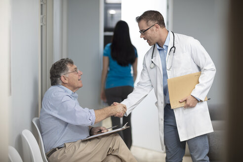 Doctor shaking hands with patient in medical practice - ZEF14540