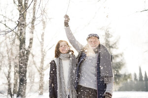 Happy senior couple in winter landscape - HAPF02168