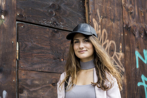 Portrait of a beautiful young woman wearing a baseball cap - LMF00786
