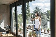Woman cleaning balcony window - JOSF01547