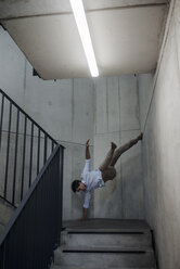 Young man balancing in staircase - JOSF01568