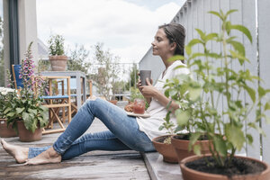 Woman relaxing on balcony - JOSF01634