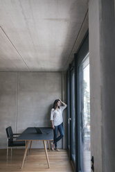 Woman looking out of window - JOSF01664