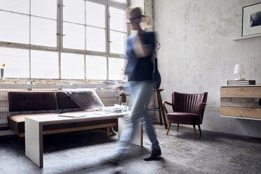 Woman walking in a loft - RBF05996