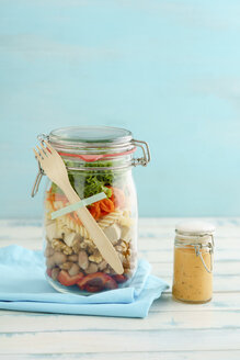Preserving jar of vegan mixed salad with tofu and pasta and jar of cocktail sauce - ECF01881