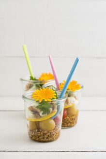 Jars of salad to go with spelt, cherry tomatoes, zucchini, walnuts, parsley, mozzarella and edible flowers - ECF01890