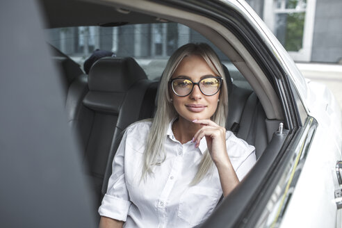 Portait of confident businesswoman with glasses in car - VPIF00034