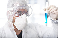 Scientist working in lab holding a test tube - ZEF14588