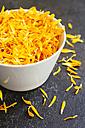 Calendula petals in a bowl - HAWF00972