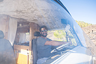 Spian, Tenerife, Mature man travelling with a vintage van - SIPF01741