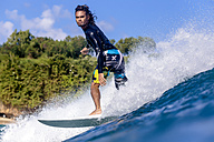 Indonesia, Bali, man surfing - KNTF00890