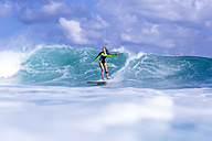 Indonesia, Bali, woman surfing - KNTF00896