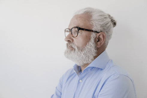 Portrait of serious mature man with beard and glasses - JOSF01698