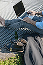 Man with beer and laptop outdoors - JOSF01737