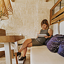 Young woman using tablet in a cafe - ZEDF00854