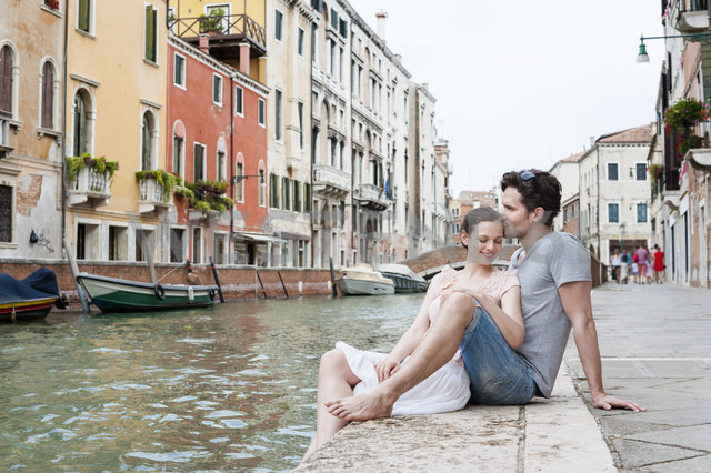 Italy, Venice, couple in love relaxing at canal - DIGF02848
