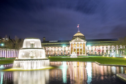 Germany, Wiesbaden, lighted Kurhaus with fountain in the foreground - PUF00718