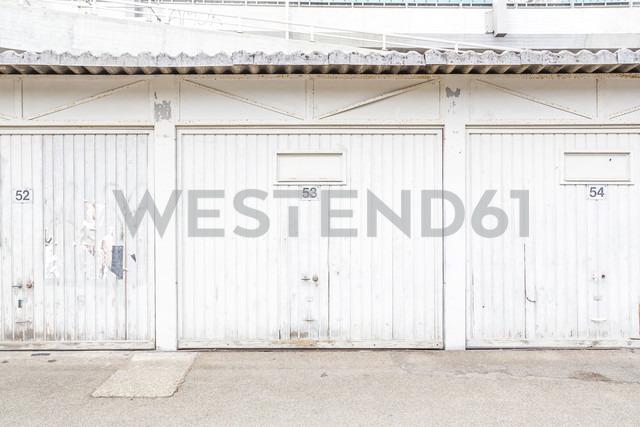 Row of three white garage doors - NGF00420
