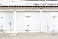 Row of three white garage doors - NGF00420