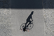 Top view of man riding bicycle - SBOF00714